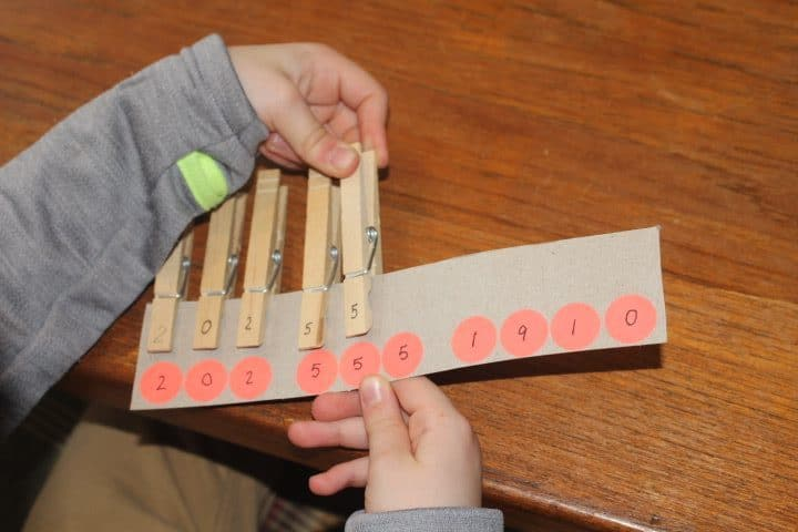 Clothes pins with numbers written on them to learn phone number