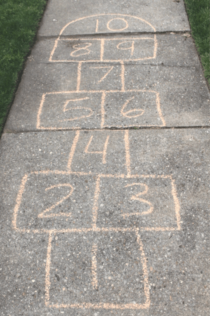 Hopscotch board alternating single jump boxes with double jump boxes as example of a learning skill for 5 yr old.