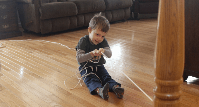 Boy pulling themselves on a rope demonstrating a core strengthening activity