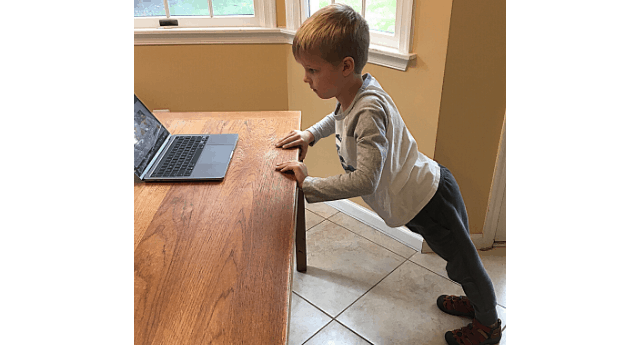 Child doing a table top pushup