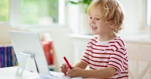 Child focusing while doing remote learning