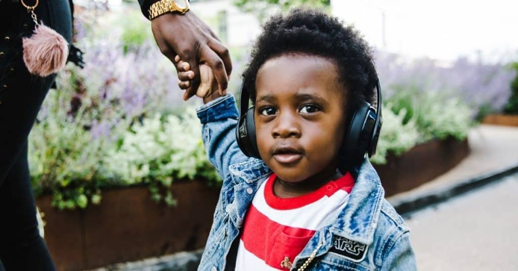 Boy wearing noise cancellation headphones to reduce auditory sensory overload